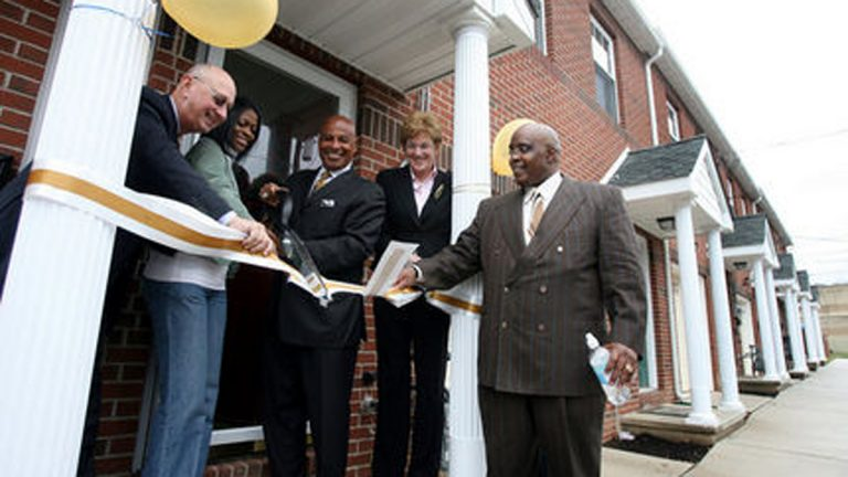 In an April 2008 photo, (from left) Robert Kahan of Tara Developers, new homeowner Tracey Ames, Trenton Mayor Doug Palmer, Marge Della Vecchia, executive director of NJ Professional Planner, and Rev. John H. Harris cut the ribbon for 10 new houses on Titus Avenue in Trenton. (Frank Jacobs III/The Times of Trenton)