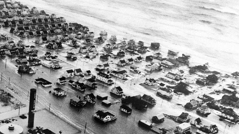Wind whipped tidal waters of the Atlantic inundate a community on Long Beach Island off the New Jersey coast on March 8, 1962. (AP File Photo)