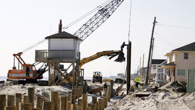 Many communities are rebuilding as fast as they can to ensure they don't miss out on the summer tourism season. (AP File Photo/Mel Evans)