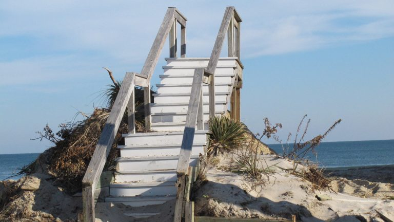 In this Nov. 29, 2012, photo, a stairway to nowhere sits on what is left of the beachfront in Toms River, N.J.  (AP Photo/Wayne Parry)