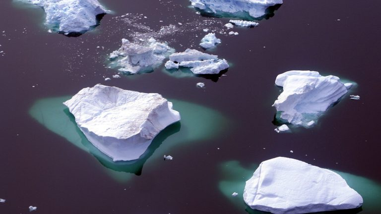 While travelling by helicopter and small aircraft, spectacular sweeping views of glaciers, icebergs and details of the Greenland ice cap can be seen over Greenland, Aug. 17, 2005. Scientists say the vast icy landscape is thinning, and many blame global warming. (AP Photo/John McConnico)