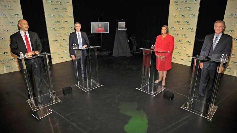 Newark Mayor Cory Booker, Rep. Rush Holt, Assembly Speaker Sheila Oliver and Rep. Frank Pallone stand during a camera test before a U.S. Senate Democratic Primary debate televised on NJTV from Montclair State University in Montclair, N.J. on Monday, Aug. 5, 2013. (AP Photo/NJTV, Joseph Sinnott)