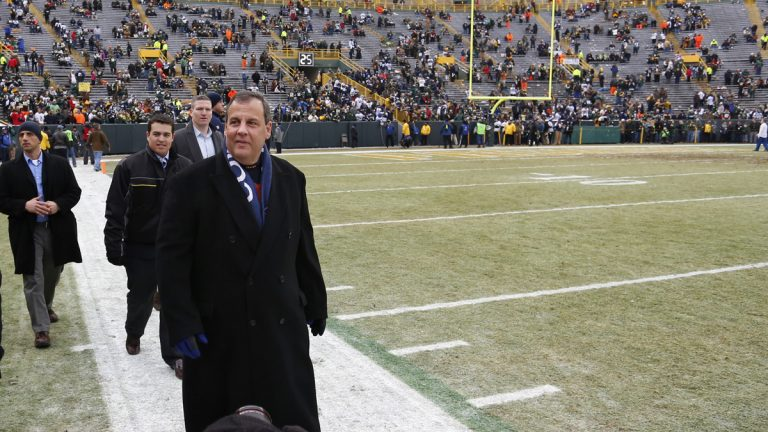 Gov Christie walks on the sidelines at Lambeau Field before Sunday's Packers vs. Cowboys game.  (AP Photo/Matt Ludtke)
