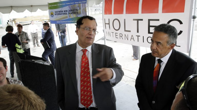 Kris Singh, center, CEO of Holtec International answers a question July 14, 2014, in Camden, N.J.. Holtec plans to build a manufacturing facility at the former site of the New York Shipbuilding Corp. yard. (AP Photo/Mel Evans)