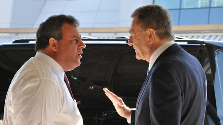 Governor Chris Christie, left, and David Samson, a former Port Authority chairman, have a conversation after a press conference at the Newark Liberty International Airport.