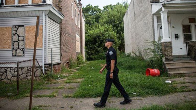 Officer Adam Fulmore, of the Camden County Police Department, goes on a foot patrol on August 22, 2013. (Andrew Burton/Getty