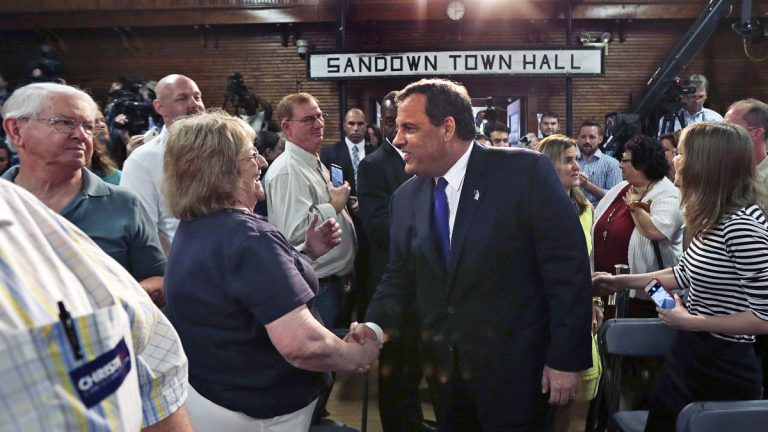 Gov. Christie shakes hands with guests as he arrives at a town hall meeting in Sandown, N.H., Tuesday June 30, 2015. (AP Photo/Charles Krupa)