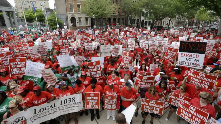 A large crowd of mostly public employee union members fill the plaza and street in front of the Statehouse Tuesday, May 12, 2015, in Trenton, N.J. The unions are protesting of Gov. Chris Christie's pension funding reductions. (AP Photo/Mel Evans)