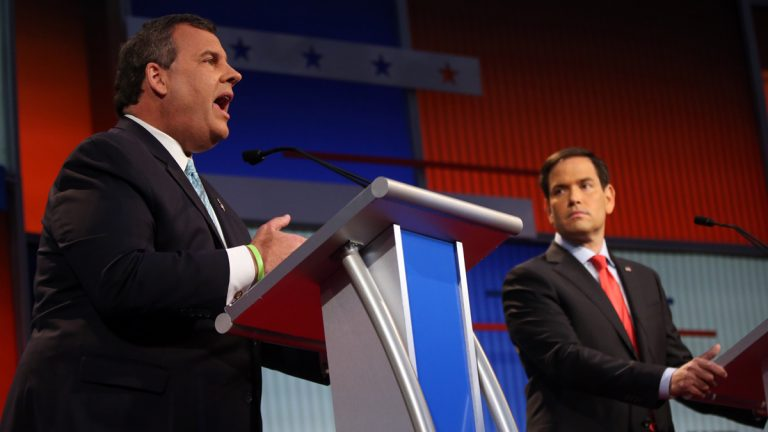 Republican presidential candidate Gov. Chris Christie speaks as Sen. Marco Rubio, R-Fla., listens during the first Republican presidential debate on Aug. 6, 2015, in Cleveland. (AP Photo/Andrew Harnik)