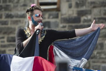 Bearded Ladies' John Jarboe, playing Edith Piaf, greets the crowd at the the 2016 Bastille Day performance.