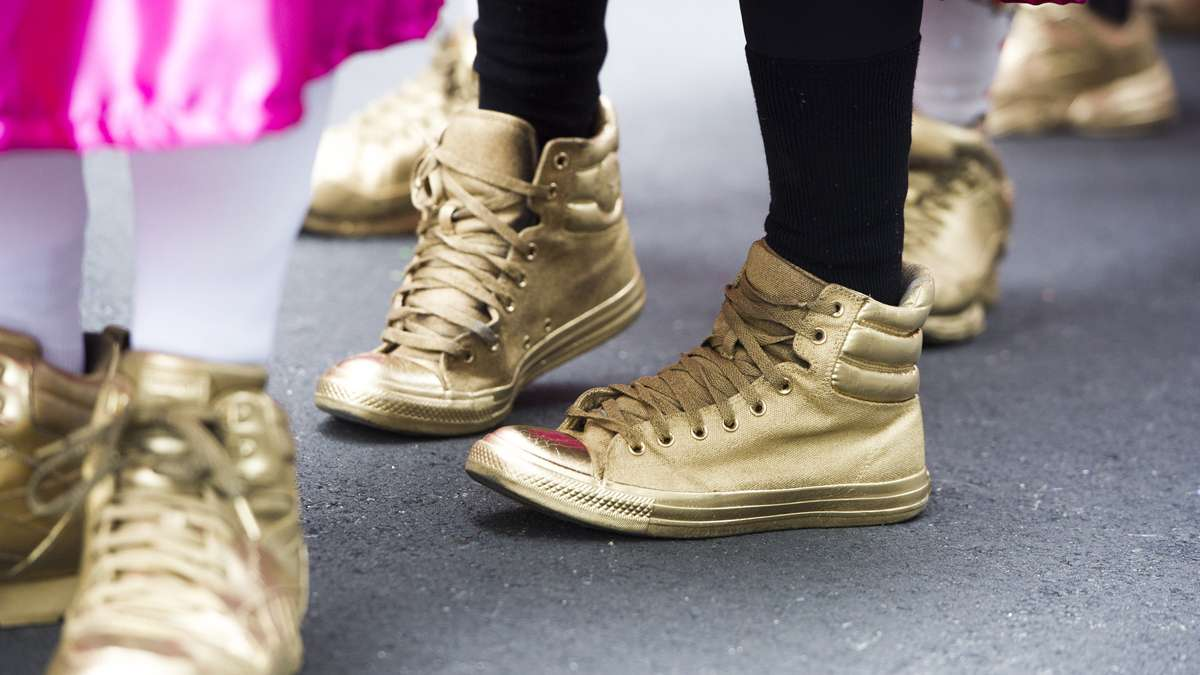 Golden ''slippers''  adorned the feet of the Two Street Stompers. (Jonathan Wilson/for NewsWorks)