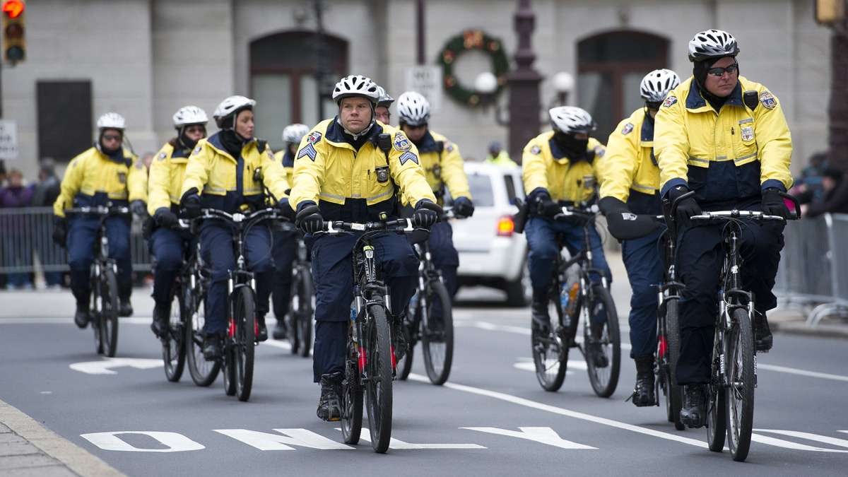 Bicycle police patrolled the parade route before and during the parade. (Jonathan Wilson/for NewsWorks)