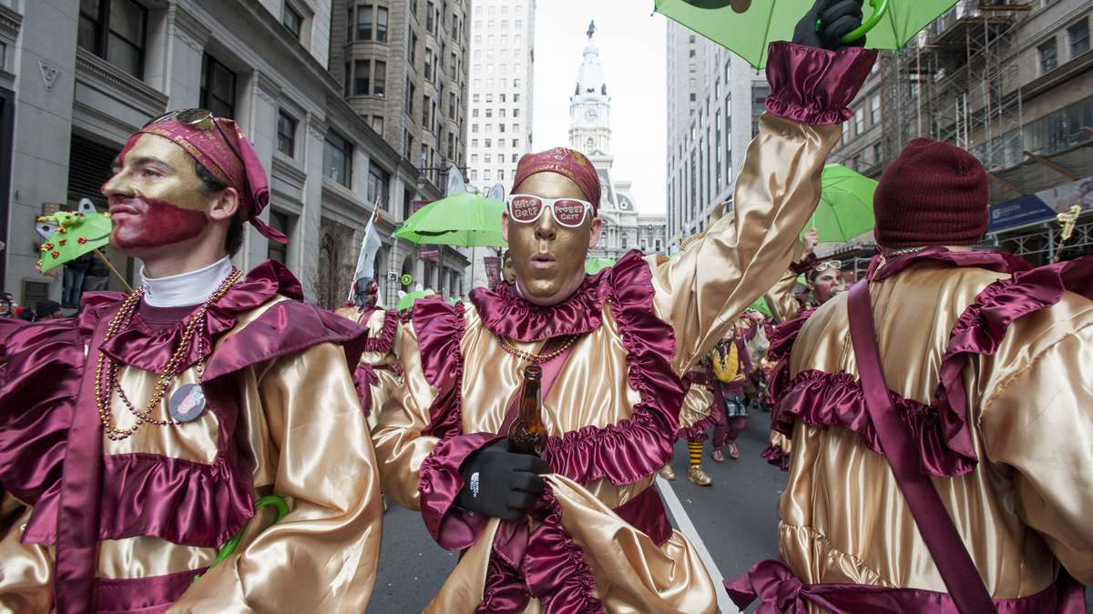 Members of the Froggy Carr Wench Brigade march down Broad Street (Jonathan Wilson/for NewsWorks)