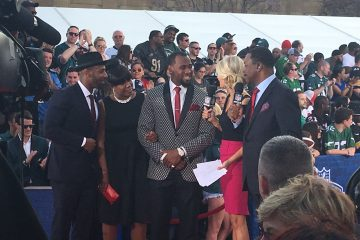 Haason Reddick, a Camden native and standout at Temple, is interviewed by the NFL Network's Melissa Stark and actor Carl Weathers prior to the first round of the NFL Draft. (Jay Scott Smith/WHYY)