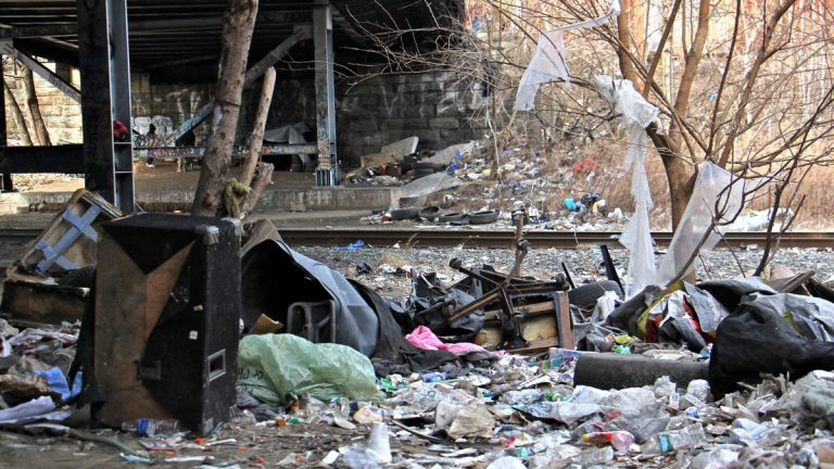 The City of Philadelphia and Conrail will work together to clean and secure the Conrail property in the Fairhill-Kensington neighborhood long used as a campground for drug addicts. (Emma Lee/WHYY)