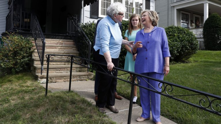 Democratic presidential candidate Hillary Clinton talks with Anne Kearns, left, as she campaigns in Scranton, Pa., Monday, Aug. 15, 2016. (AP Photo/Carolyn Kaster)