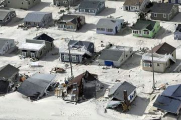 In this aerial photo, sand fills the streets in the wake of Superstorm Sandy, Wednesday, Oct. 31, 2012, along the Jersey Shore, N.J. (Mike Groll/AP Photo)