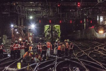 In this Wednesday, April 5, 2017 photo provided by Amtrak, workers repair rails inside New York's Penn Station. (Chuck Gomez/Amtrak via AP)