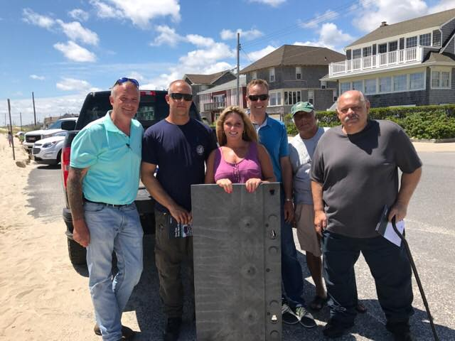 (L to R): Beach Days for All's Chris Aldrich, Seaside Park Public Works Director Eric Wojciechowski, Beach Days for All's Jessica Krill, Joseph Wright of Matrax, Inc., Seaside Park Councilman Ray Amabile, and Seaside Park Borough Administrator Bob Martucci stand in front of a Seaside Park beach.