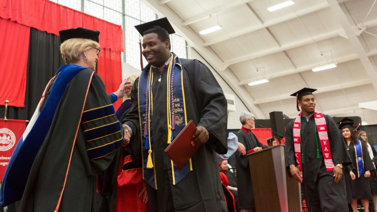 Students accept their diplomas at the 2016 spring commencement at East Stroudsburg University. The school has succeeded in narrowing the graduation gap between black and white students while boosting minority enrollment. (East Stroudsburg University)