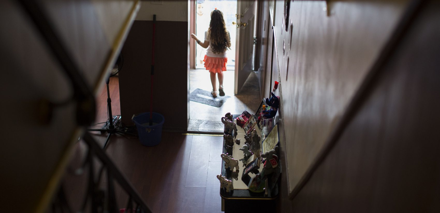 Layla Zayas stands at the front door of her home in Kensington. (Jessica Kourkounis/For Keystone Crossroads)