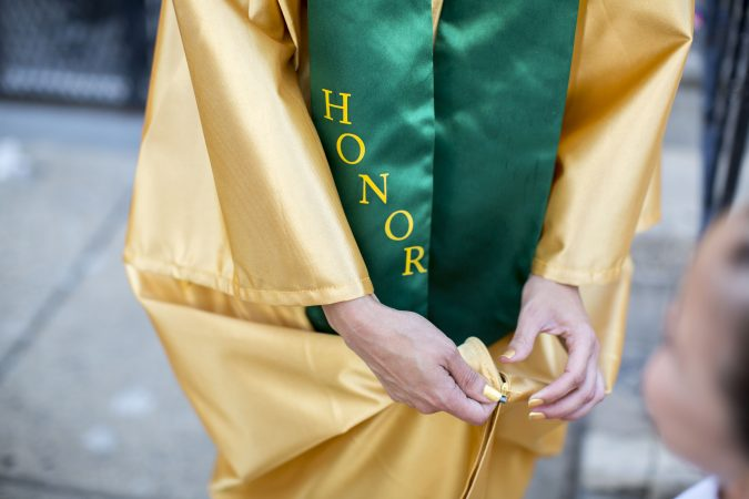 Savannah finished her senior year with a cumulative GPA that ranked her in the top 25 of her class, a designation that earned her a special gold gown and green sash. (Jessica Kourkounis/For Keystone Crossroads)