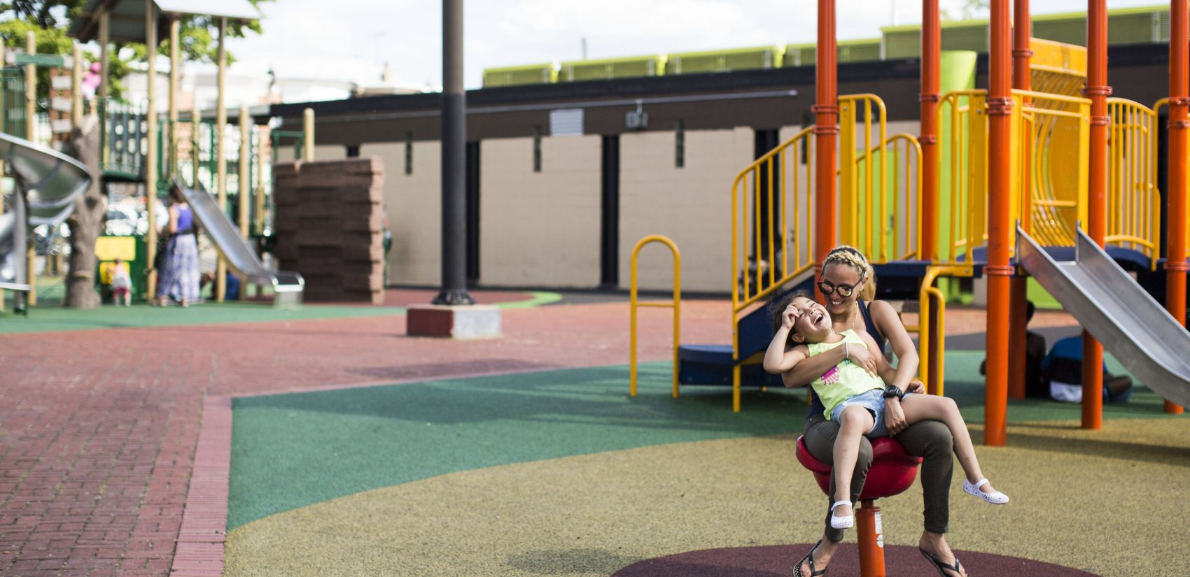 </b> Savannah Zayas and her daughter Layla play at Cione Playground in Kensington on June 29, 2016. Savannah doesn't take Layla to parks in her own neighborhood. (Jessica Kourkounis)