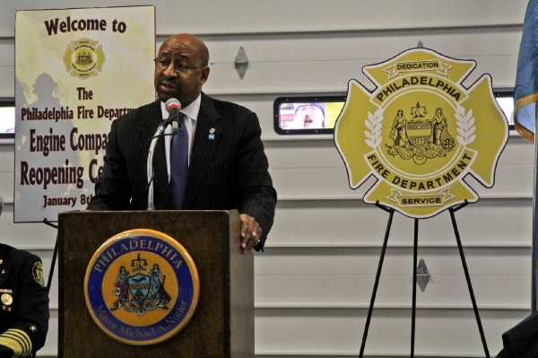 <p>A Local 22 member yells through the window for the recall of Mayor Michael Nutter as he speaks at the dedication of Engine 38 in the Tacony section of Philadelphia. (Kimberly Paynter/WHYY)</p>