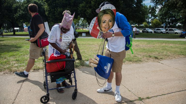 Street vendors sell Hillary Clinton and Bernie Sanders head signs to protesters outside of the Wells Fargo Center, site of   the 2016 Democratic National Convention. (Emily Cohen for NewsWorks)