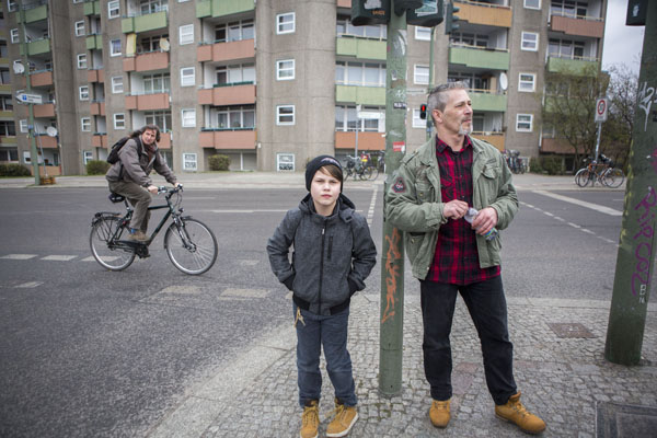 Andreas Rissmann (right), a single father, walks with his son Lysander in the Wedding section of Berlin, Germany. (Jessica Kourkounis/For Keystone Crossroads)