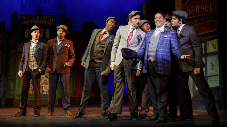 Steve Rosen as Nathan Detroit (in blue-checkered jacket) and some of the the cast of 'Guys and Dolls' at Bucks County Playhouse. (Photo courtesy of Joan Marcus)
