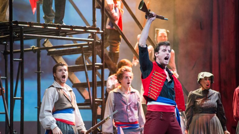 Sean Thompson (in front), leads the student rebels in Media Theatre's production of 'Les Misérables.' (Photo courtesy of Maura McConnell)