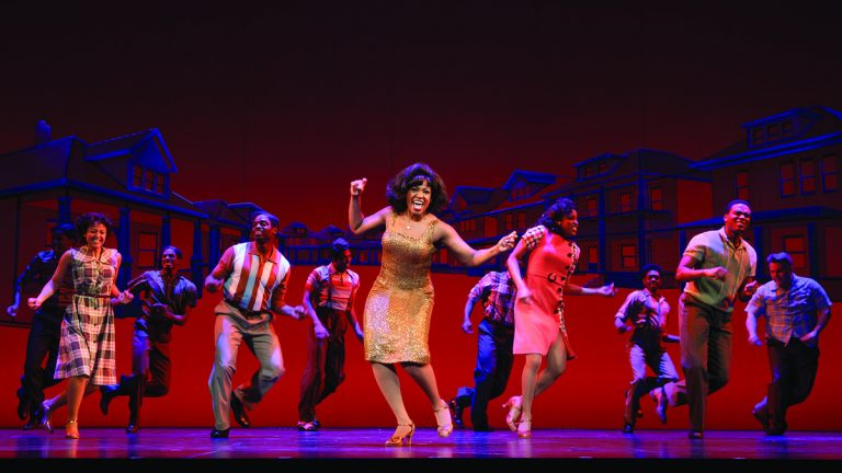 Patrice Covington, in gold outfit, as Martha Reeves (from Martha and the Vandellas) in 'Motown: The Musical' at the Academy of Music. (Photo courtesy of Joan Marcus)