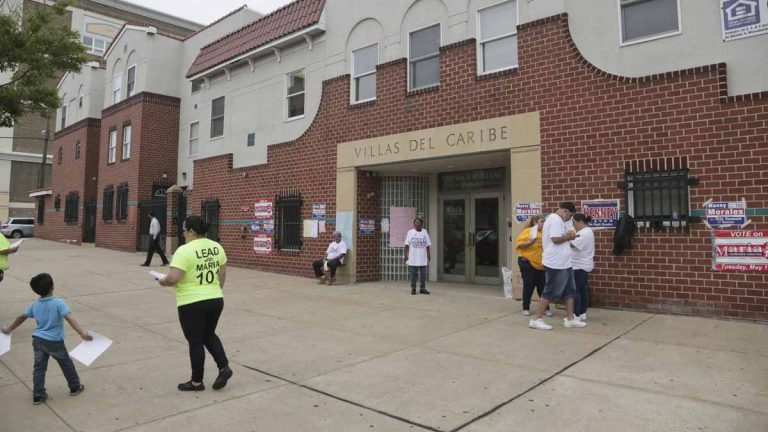 Election officials at the Villas del Caribe on Allegheny Avenue confirmed that voting machines were malfunctioning, causing discrepancies between voter signatures and machine votes. (Kevin Cook/ for NewsWorks)