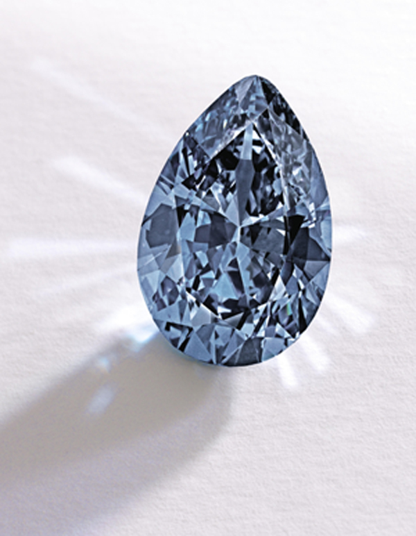 In this image provided by Sotheby's shows a Fancy Vivid Blue pear-shaped diamond from the estate of Rachel