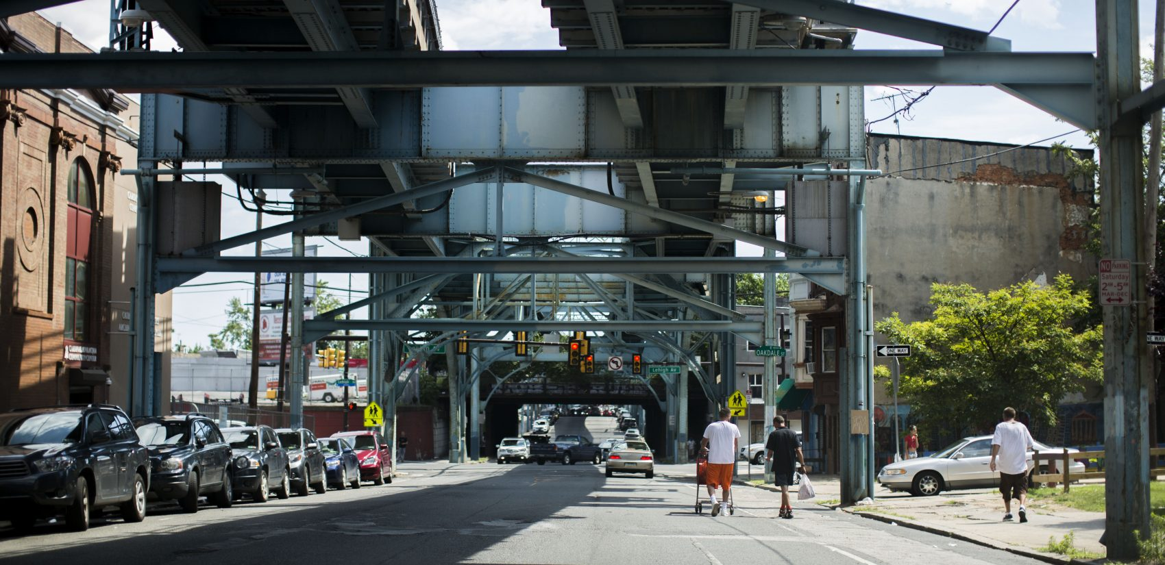 The tracks of Philadelphia's Market-Frankford El train run above Front Street through Kensington. (Jessica Kourkounis/For Keystone Crossroads)