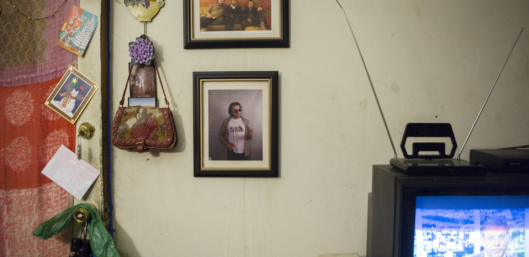 Photos of Josie Buriak's son Max hang on the wall of her living room in Pittsburgh. (Jessica Kourkounis/For Keystone Crossroads)