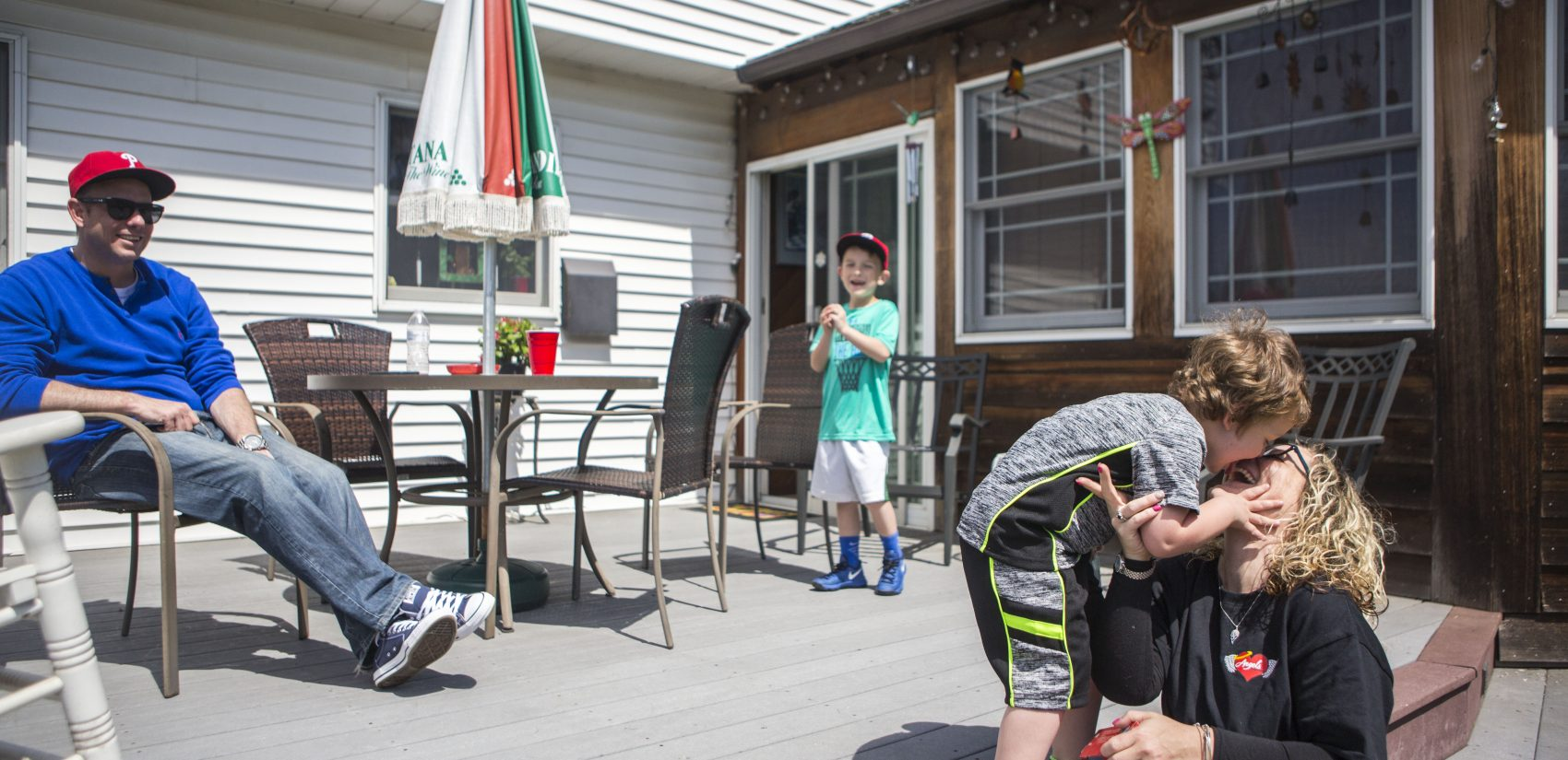 Nicole O'Donnell (right) spends a Sunday at her parent's home in Delaware County, Pennsylvania with her son Joey, her fiancéŽ Bill Meighan, and his son Ryan. (Jessica Kourkounis/For Keystone Crossroads)