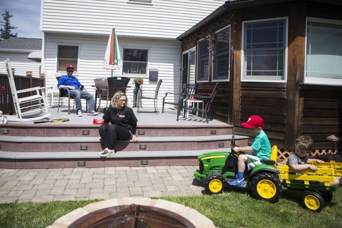 Nicole O'Donnell (right) spends a Sunday with family at her parent's home in Delaware County, Pennsylvania. (Jessica Kourkounis/For Keystone Crossroads)