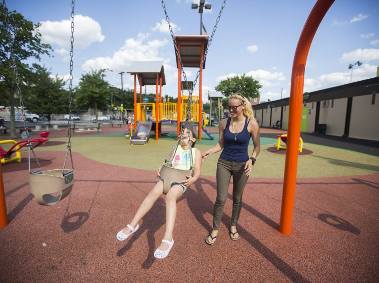 Savannah Zayas and her daughter Layla play at Cione Playground in Kensington on June 29, 2016. Savannah doesn't take Layla to parks in her own neighborhood. (Jessica Kourkounis)