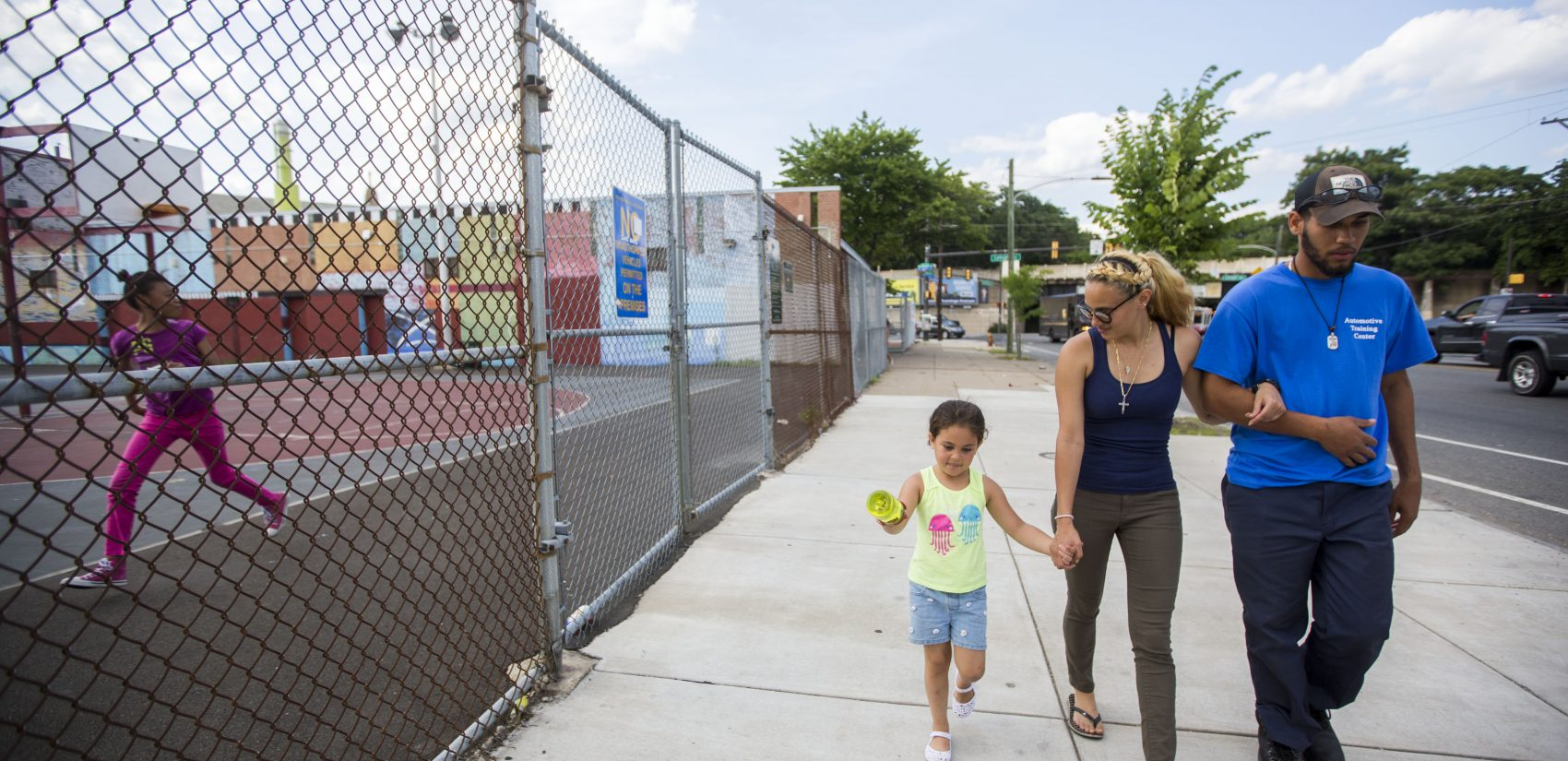 Savannah and Layla walk with Luis Felix (right), who hopes to become a mechanic. (Jessica Kourkounis/For Keystone Crossroads)