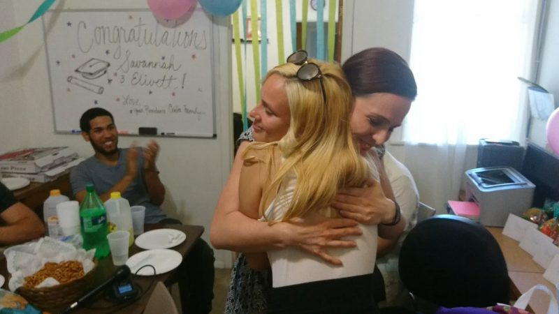 Slideshow: Savannah hugs Maura Bernt, Providence's director of youth programs, at a party the non-profit threw to celebrate their graduating teen leaders. (Kevin McCorry/WHYY)