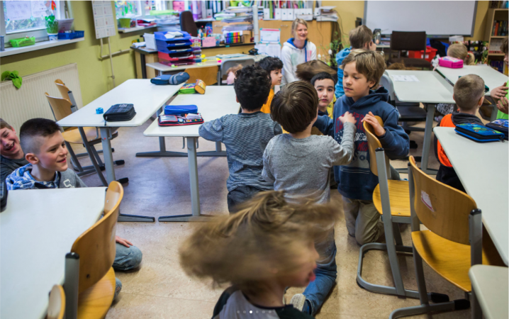 Students do a warm up exercise at Gustav Falke elementary school in the Wedding section of Berlin, Germany. (Jessica Kourkounis/For Keystone Crossroads)