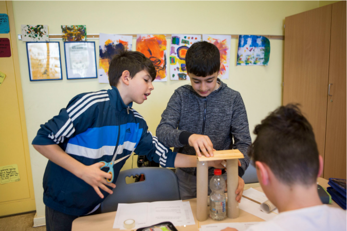 Fourth grade students construct a model tower in class at Gustav Falke elementary. (Jessica Kourkounis/For Keystone Crossroads)