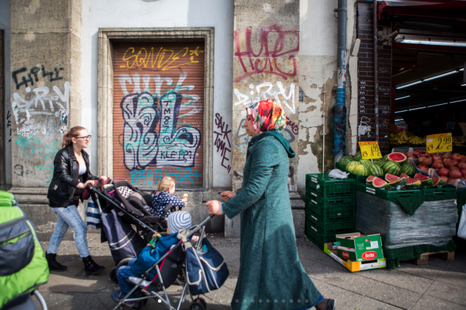 Mothers hurry down a busy street pushing their children in the Wedding section of Mitte. (Jessica Kourkounis/For Keystone Crossroads)