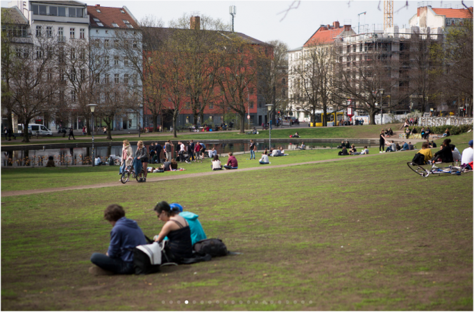 People sit in the grass and stroll through a sprawling park in Old Mitte, a section of Berlin that boomed after German reunification in 1990. (Jessica Kourkounis/For Keystone Crossroads)