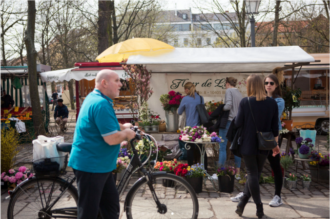 Flowers and artisanal goods and food are sold at Arkonaplatz Markt, a popular outside market, on the wealthier side of Mitte's social divide. (Jessica Kourkounis/For Keystone Crossroads)
