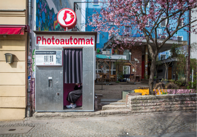A Photo Booth on a park lined street in Old Mitte. (Jessica Kourkounis for Keystone Crossroads)