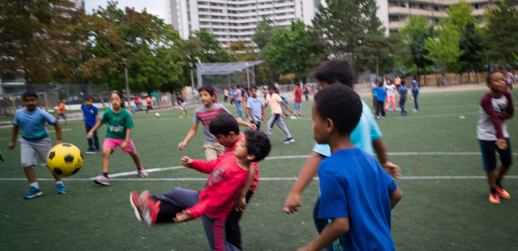 Students play soccer during recess, at Rose Avenue Public School in Toronto, Ontario, Canada. (Ian Willms/For Keystone Crossroads)