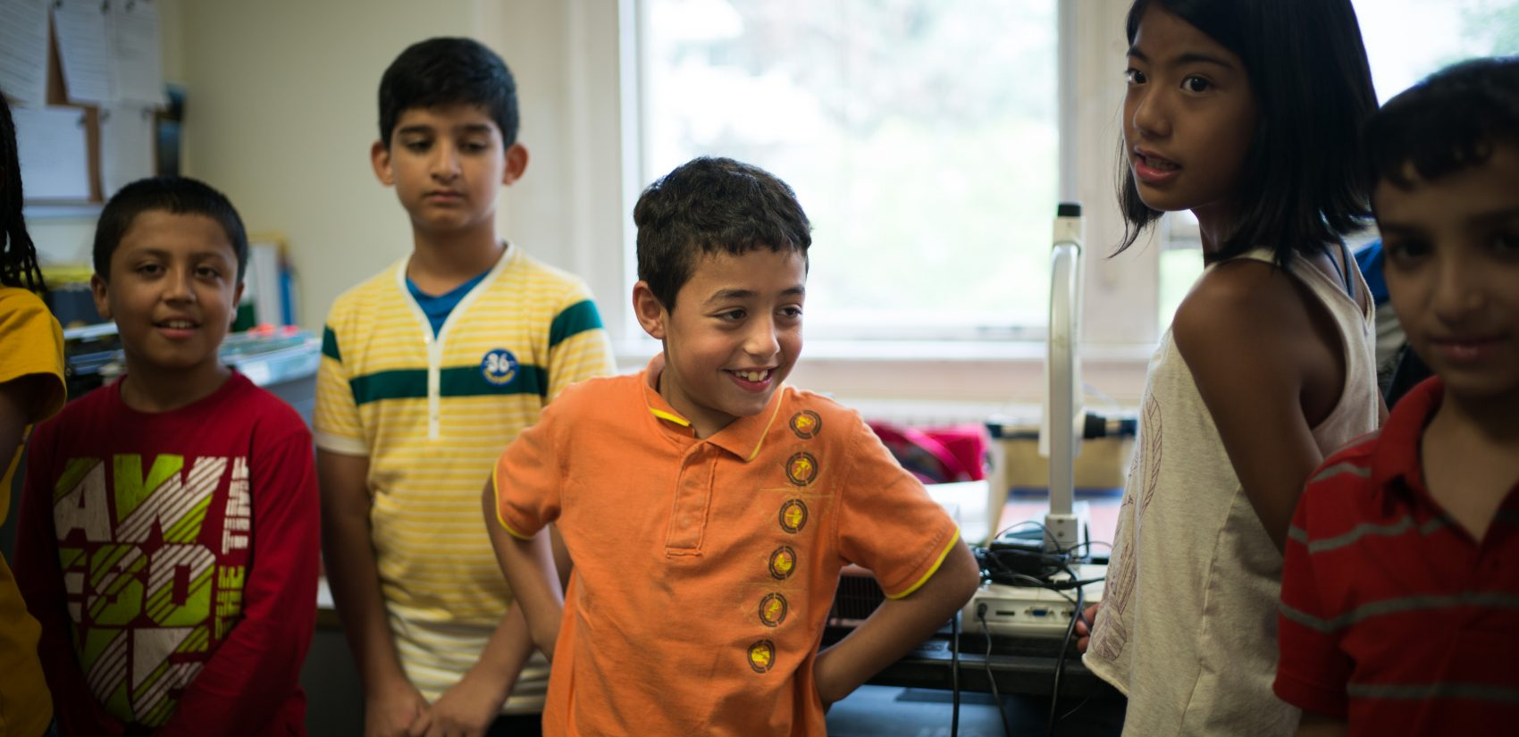 Taki Alaid (center), a student at Rose Avenue Public School, in Toronto, Ontario, Canada. (Ian Willms/For Keystone Crossroads)